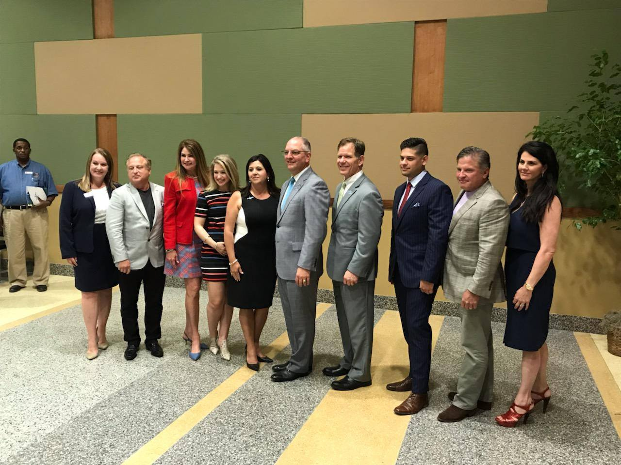 The Leto and Smith families take a photo with Governor John Bel Edwards, Parish President Robby Miller, TEDF Executive Director, Ginger Cangelosi, and Hammond Chamber CEO, Melissa Bordelon