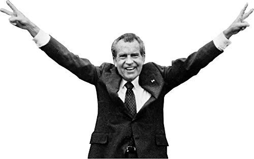 Image of Richard Nixon with arms raised giving the peace sign with both hands